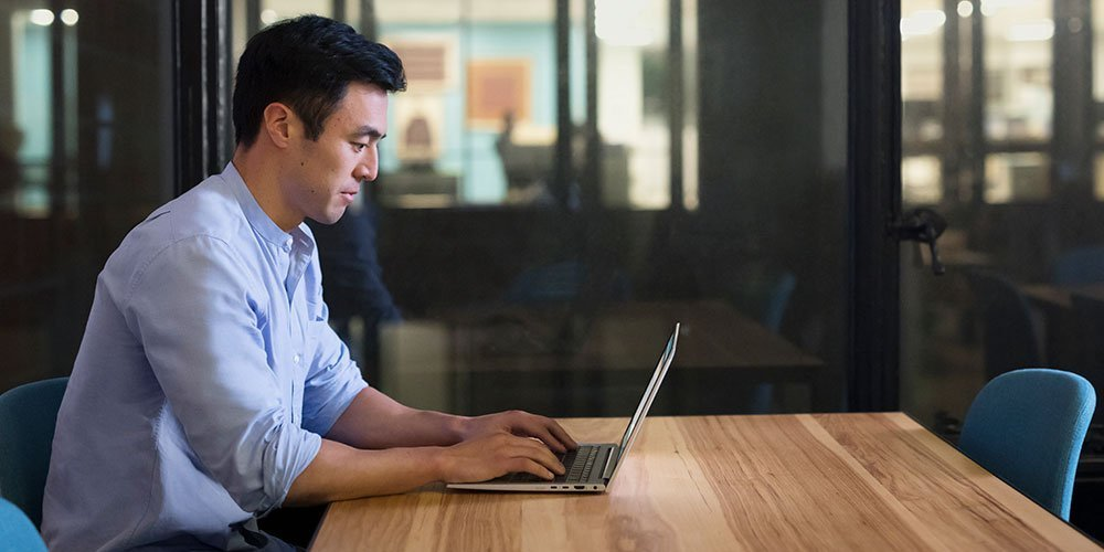A office man doing his works with a risk-free HP laptop